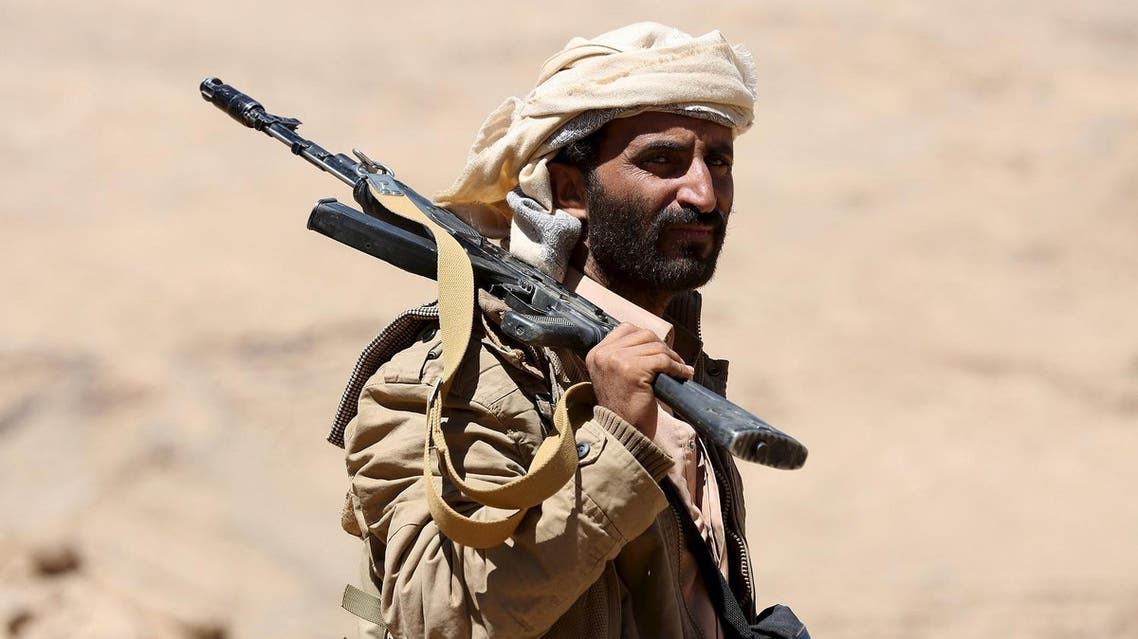 A pro-government government tribal fighter carries his weapon as he walks in Fardhat Nahm area, which has recently been taken by the army from Houthi rebels around 60km (40 miles) from Yemen's capital Sanaa, February 20, 2016. REUTERS