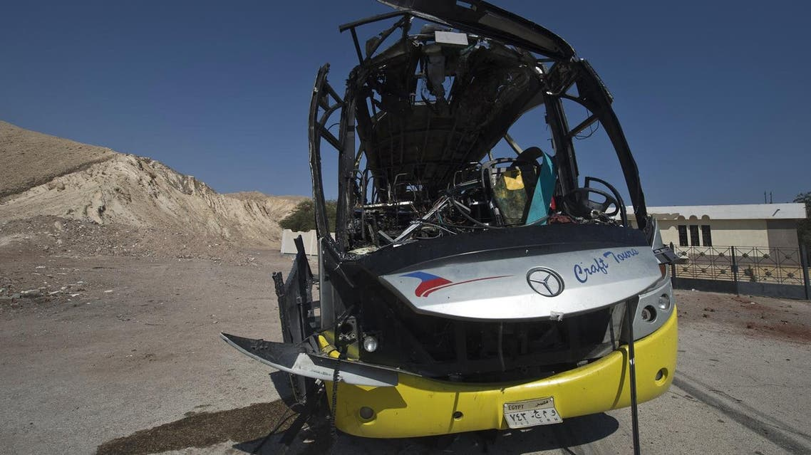 The wreckage of a tour bus that was targeted by a suicide bombing on February 16 is seen in south Sinai resort town of Taba on February 18, 2014. (File photo: AFP)