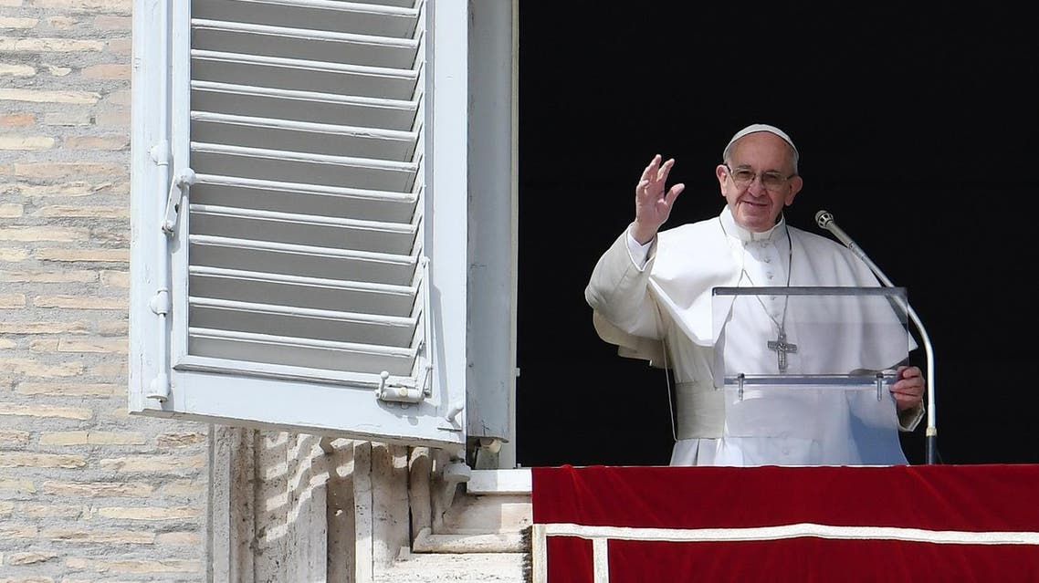 Pope Francis waves to the crowd from the window of the apostolic palace during the Sunday Angelus prayer, on March 5, 2017 at St Peter's square in Vatican. (AFP)