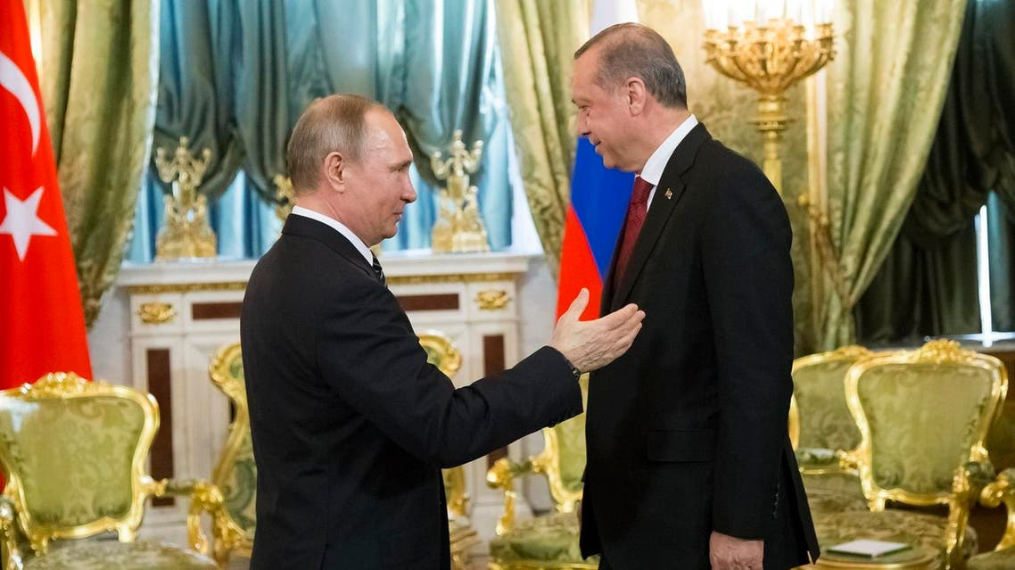 Russian President Vladimir Putin, left, speaks to Turkey's President Recep Tayyip Erdogan during their meeting in the Kremlin in Moscow, Russia, Friday, March 10, 2017. (AP)
