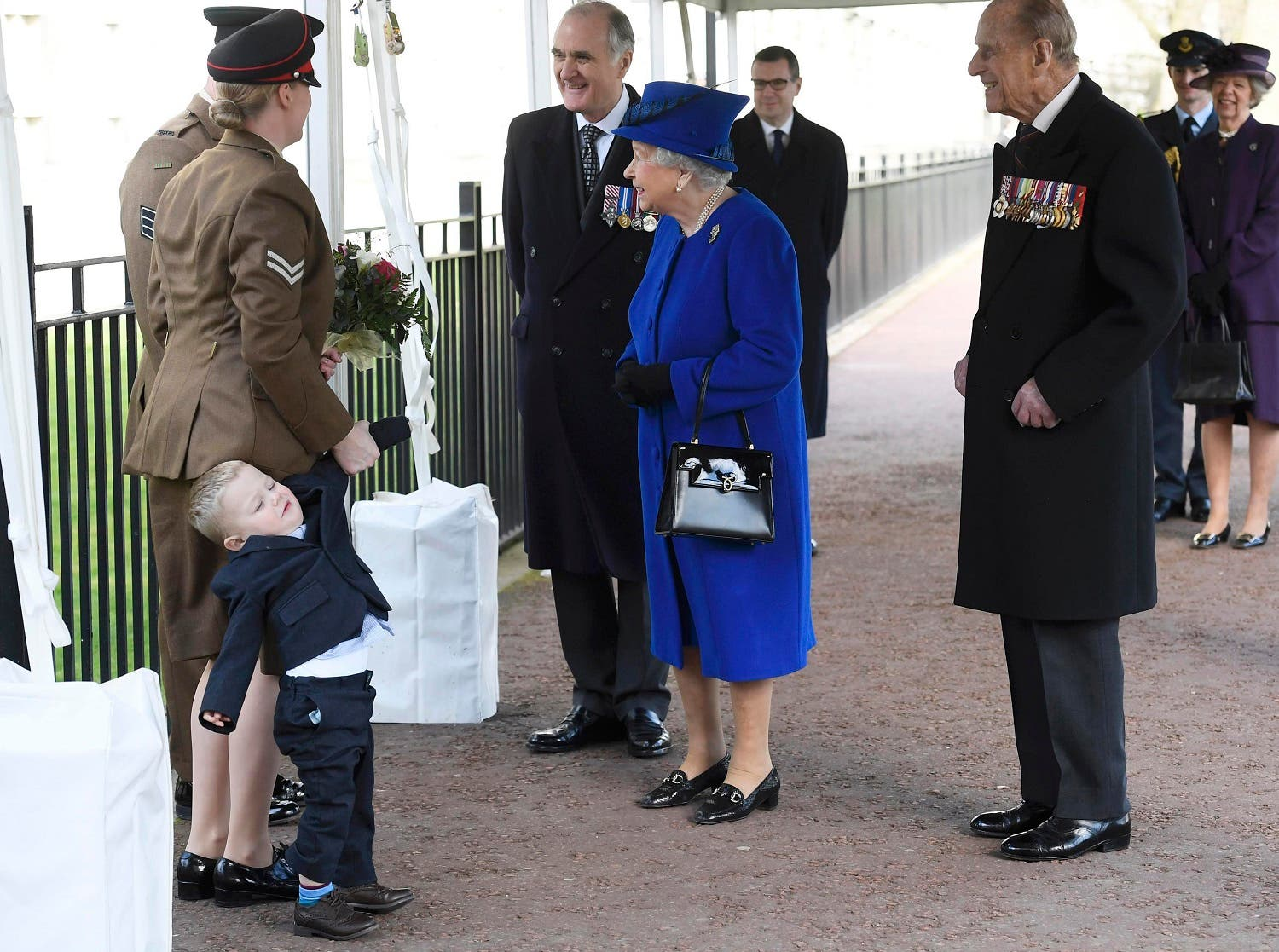 Michelle Lun, left, holds on to her son Alfie, 2-years-old as they meet Britain's Queen Elizabeth II at the unveiling during the the unveiling of a national memorial honouring the Armed Forces and civilians who served their country during the Gulf War and conflicts in Iraq and Afghanistan in London Thursday March 9, 2017. (AP)
