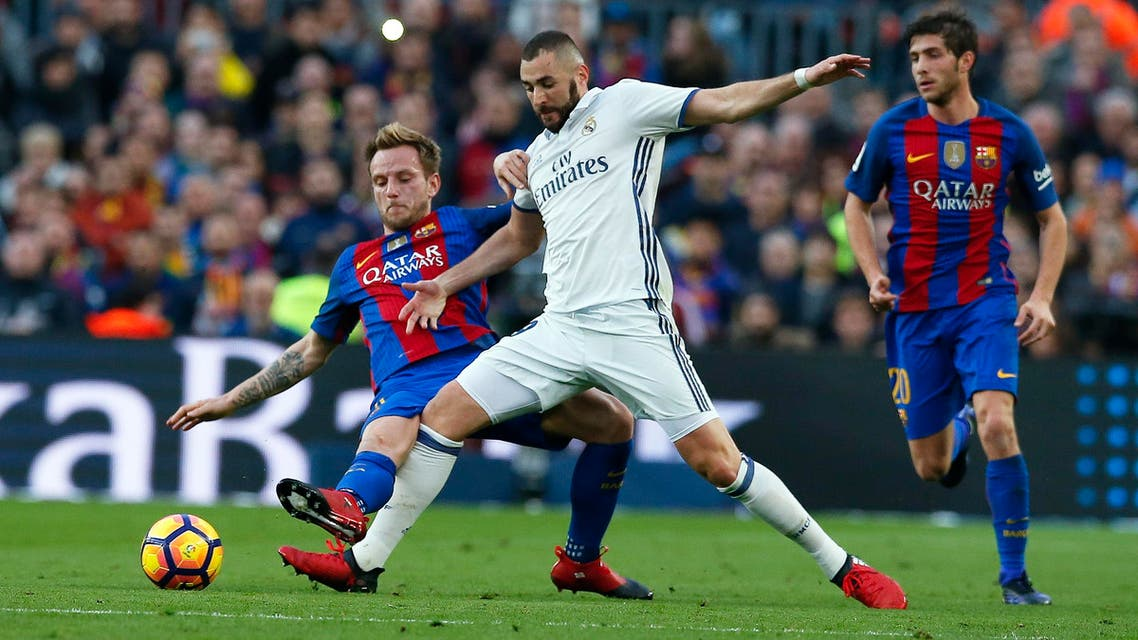 """Real Madrid's Karim Benzema and Barcelona's Ivan Rakitic in action during the """"Clasico"""". (reuters)"""