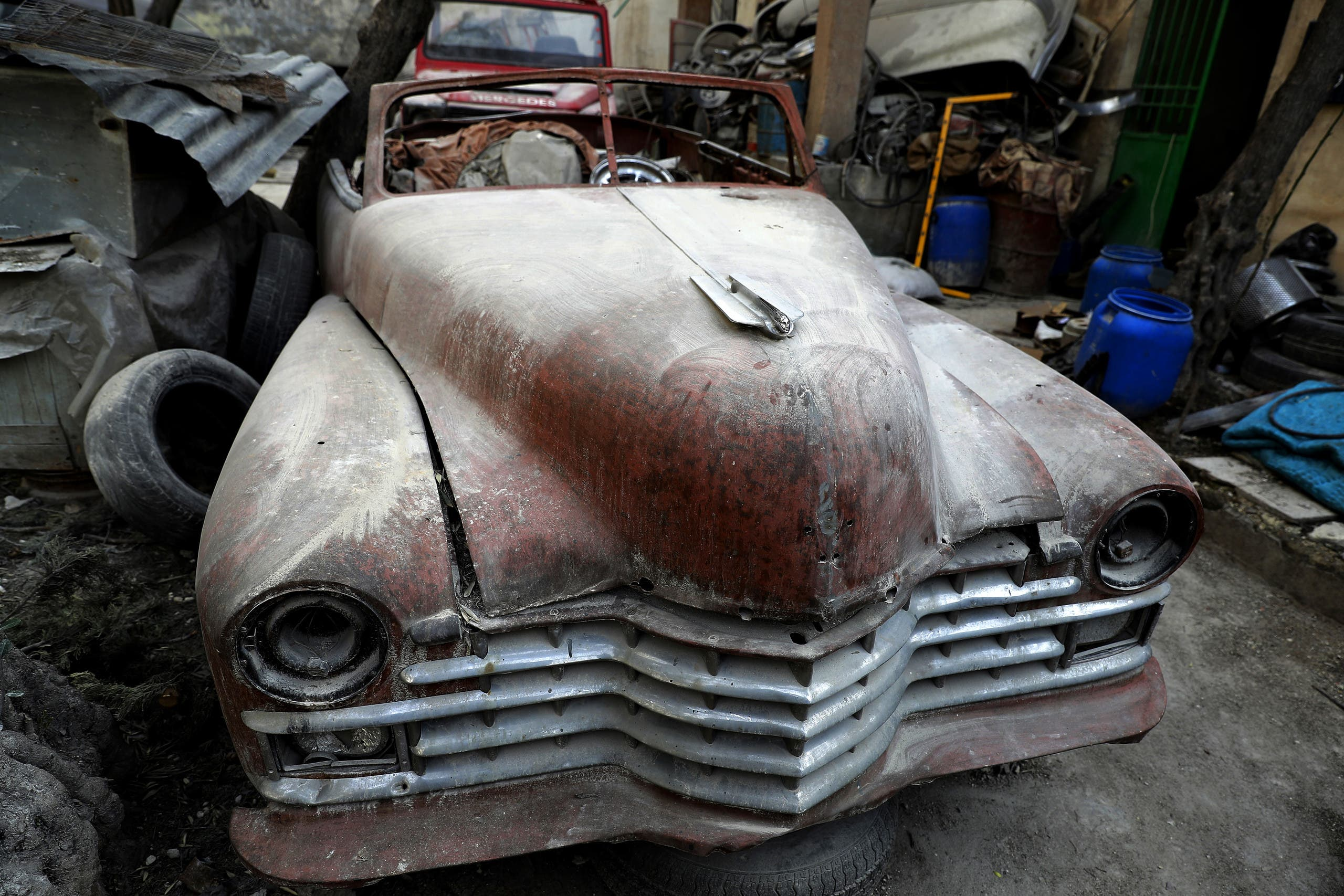 A picture taken on March 9, 2017, shows a 1947 Cadillac parked in the garden of Mohammad Mohiedine Anis' home in Aleppo's formerly rebel-held al-Shaar neighbourhood. AFP