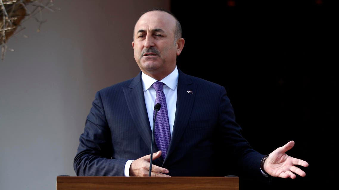 Turkish Foreign Minister Mevlut Cavusoglu holds a press conference with the Turkish Cypriot leader after a meeting on February 21, 2017, in the northern part of Nicosia, in the self proclaimed Turkish Republic of Northern Cyprus (TRNC). AFP