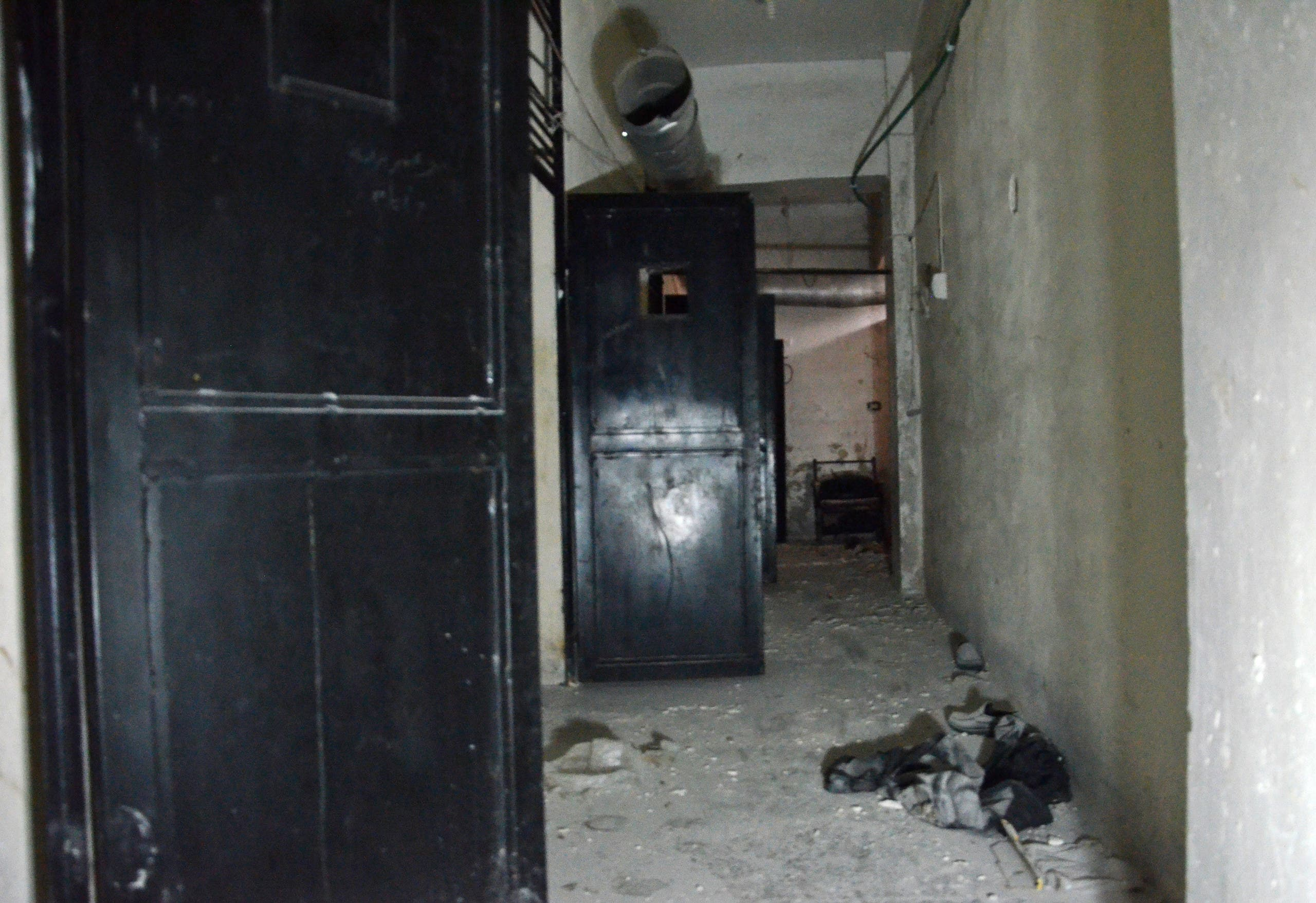 A picture taken on March 2, 2017 shows the open cell-doors in a hallway in an Islamic State (IS) group prison in the northern Syrian town of al-Bab, after Turkish-backed rebels announced the recapture of the town from IS.