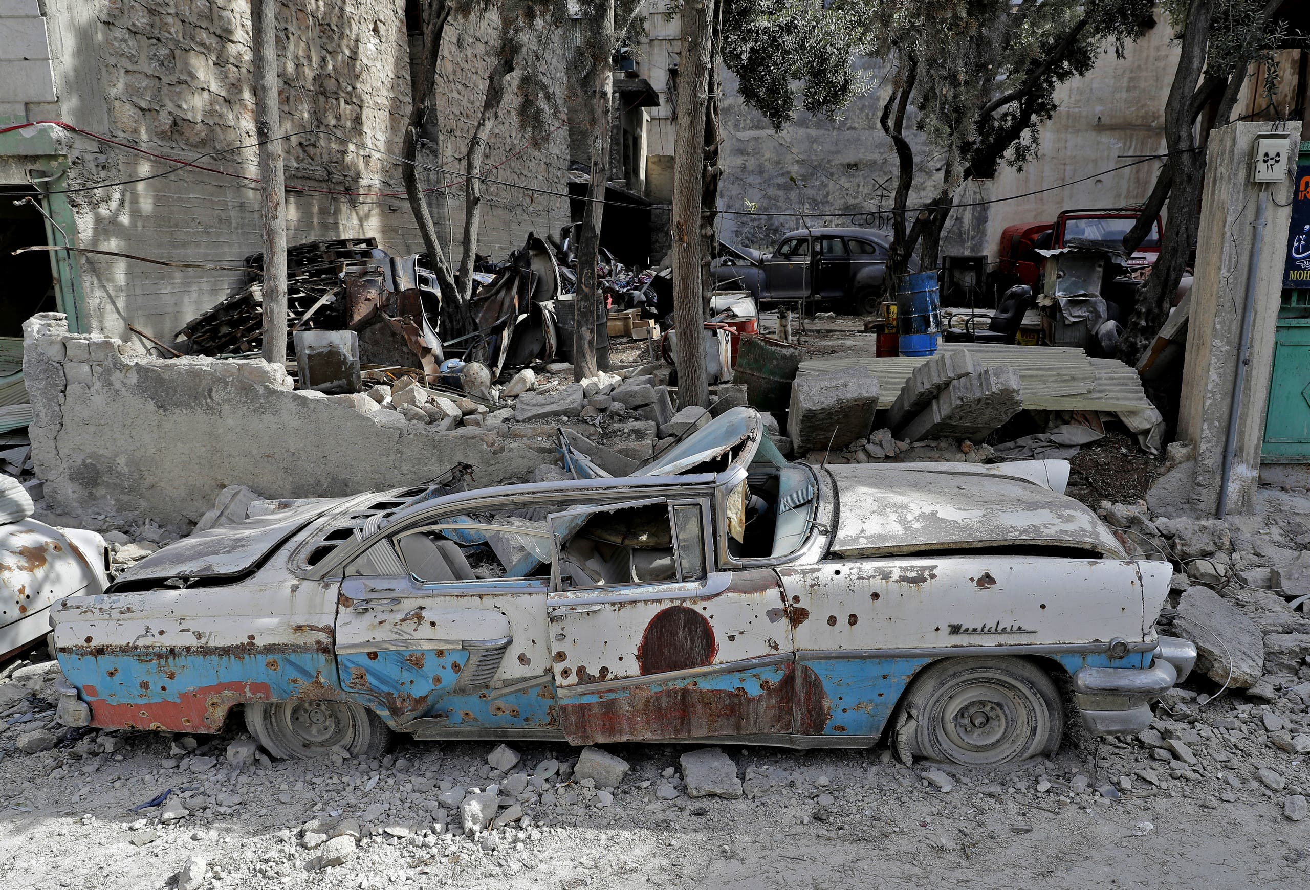 A picture taken on March 9, 2017, shows a 1957 Mercury Montclair parked outside the home of Mohammad Mohiedine Anis in Aleppo's formerly rebel-held al-Shaar neighbourhood. AFP