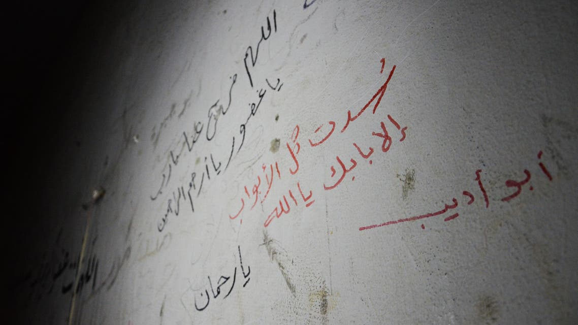 """A picture taken on March 2, 2017 shows Arabic writings on cell walls, written by prisoners held captive by Islamic State (IS) group, reading: """"All doors have been shut but yours, O God,"""" in an IS prison in the northern Syrian town of al-Bab, after Turkish-backed rebels announced the recapture of the town from IS. AFP"""