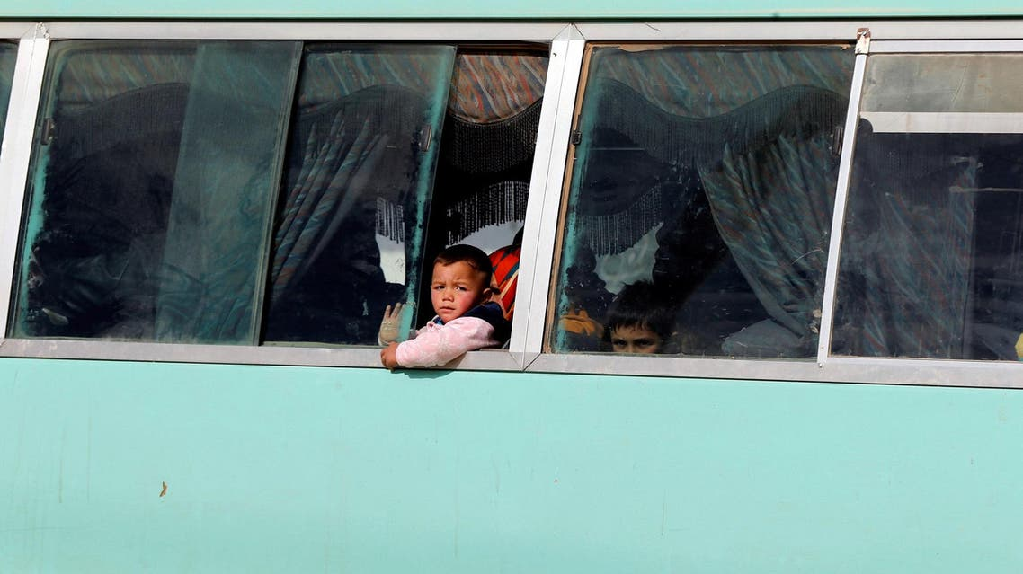 Syrian refugee children sit on the bus as they leave with their family after shopping for humanitarian aid at Tazweed centre in the Al-Zaatari refugee camp, in Mafraq, Jordan. (Reuters)