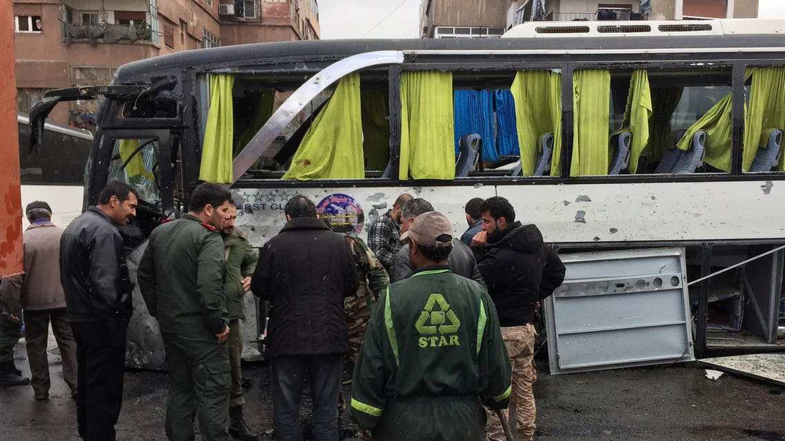 Syrian army soldiers and civilians inspect the damage at the site of an attack by two suicide bombers in Damascus, Syria March 11, 2017. REUTERS/Omar Sanadiki