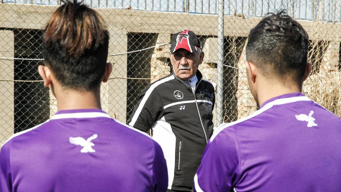 Kadhim Flayeh, a mute Iraqi football coach, uses sign language and hand gestures to train players at a football pitch in Baghdad, on January 30, 2017. (AFP)