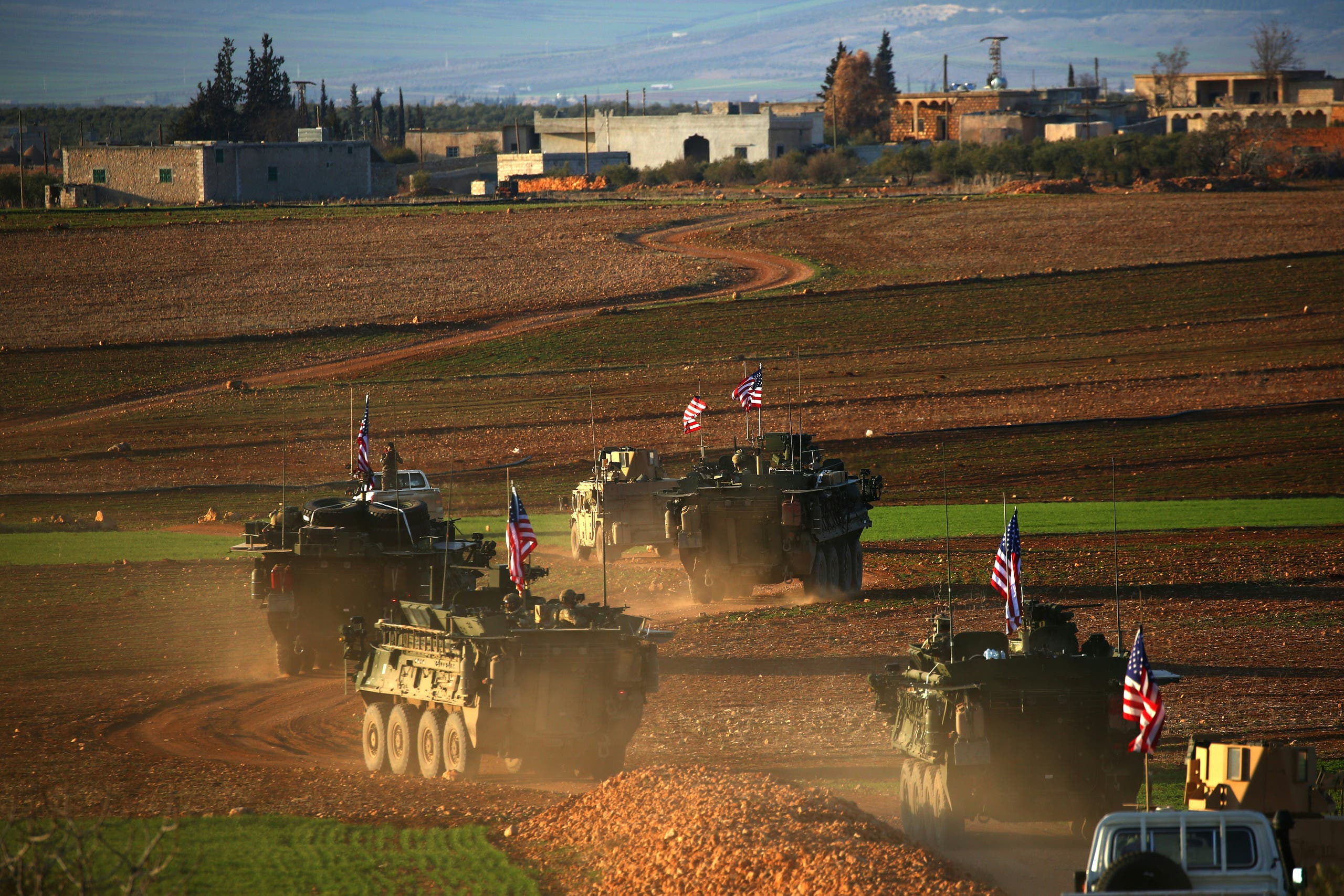 A convoy of US forces armoured vehicles drives near the village of Yalanli, on the western outskirts of the northern Syrian city of Manbij, on March 5, 2017. AFP