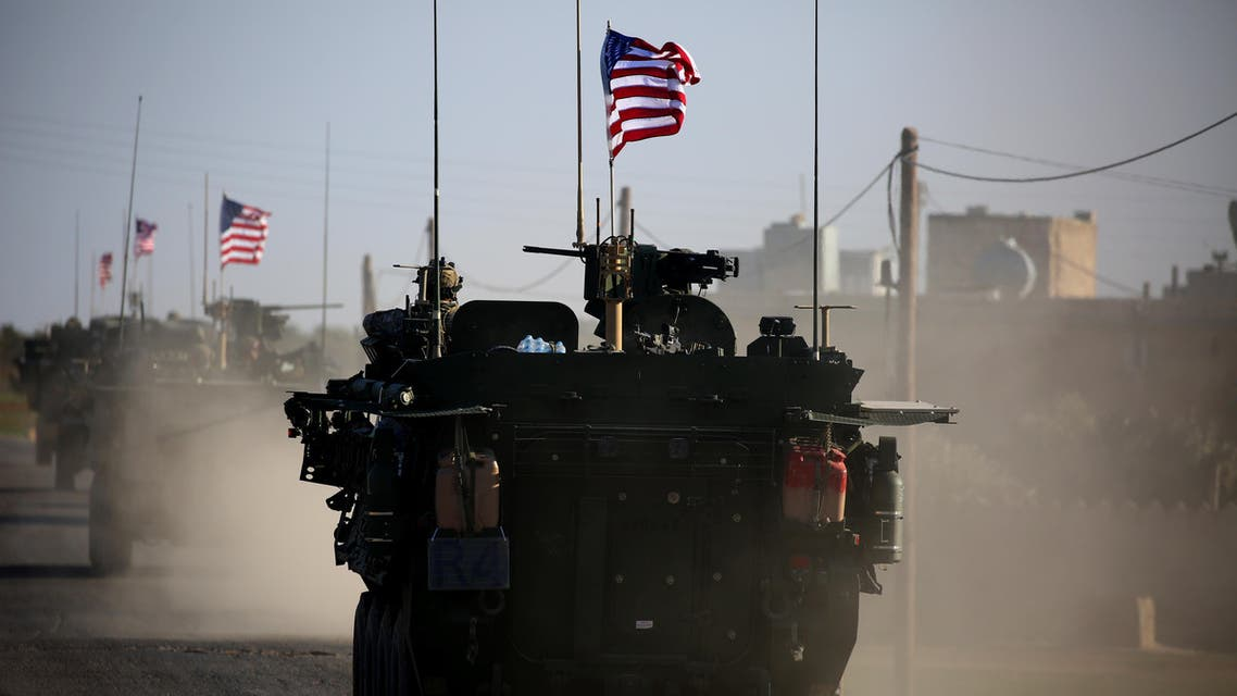 A convoy of US forces armoured vehicles drives near the village of Yalanli, on the western outskirts of the northern Syrian city of Manbij, on March 5, 2017.
