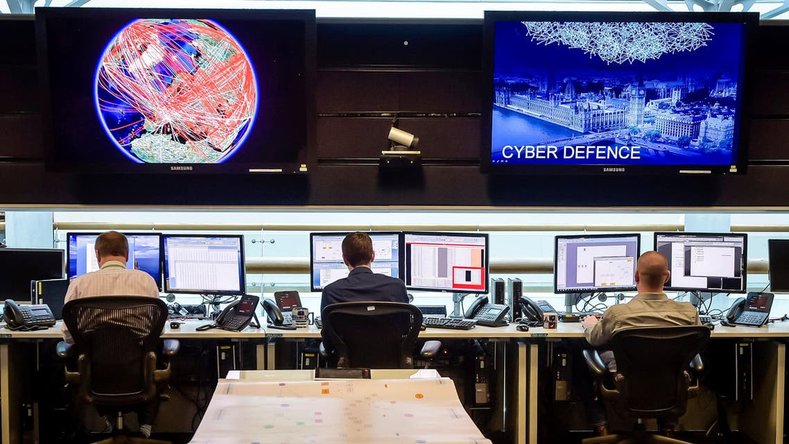 People sit at computers in the 24 hour Operations Room inside GCHQ, Cheltenham in Cheltenham, England, November 17, 2015