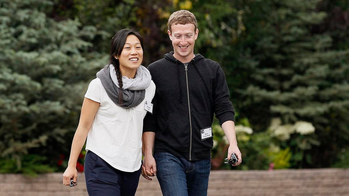 Facebook CEO Mark Zuckerberg walks with his wife Priscilla Chan at the annual Allen and Co. conference at the Sun Valley, Idaho Resort July 11, 2013. (Reuters)