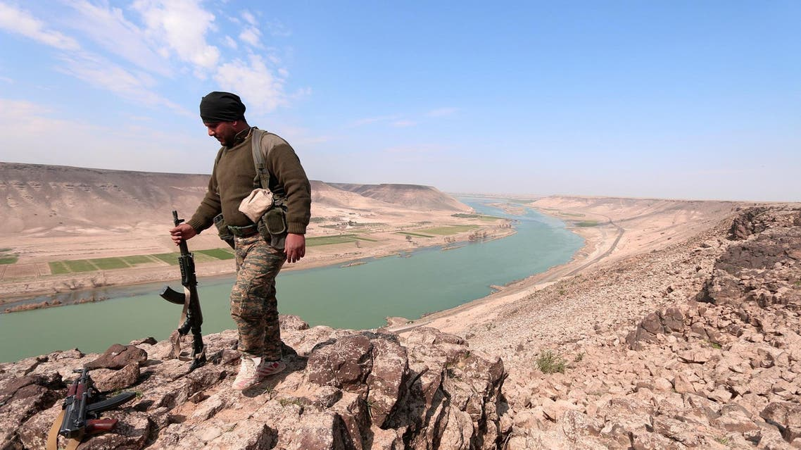 A Syrian Democratic Forces(SDF) fighter poses for a picture near Euphrates River, north of Raqqa city, Syria March 8, 2017. (Reuters)