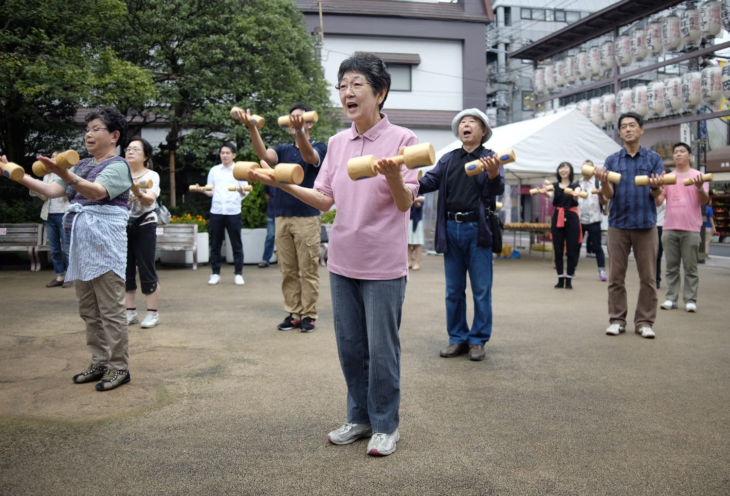Elderly people work out with wooden dumb-bells in the grounds of a temple in Tokyo on September 19, 2016, to celebrate Japan's Respect for the Aged Day. (AFP)