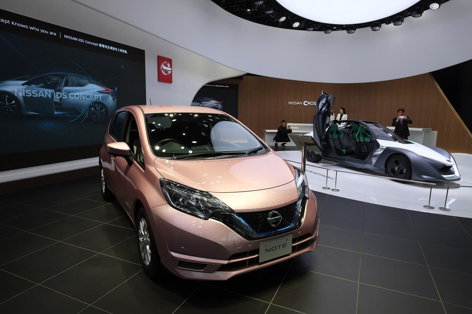 Nissan Motor's latest passenger vehicle 'Note' (L) and an electric concept vehicle 'BladeGlider' (R) are displayed at a showroom in Tokyo on February 23, 2017. (AFP)