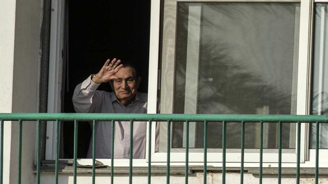 This file photo taken on October 6, 2016 shows Egypt's former president Hosni Mubarak waving to people from his room at the Maadi military hospital in Cairo, as his supporters gather to celebrate the 43rd anniversary of October War victory. (AFP)