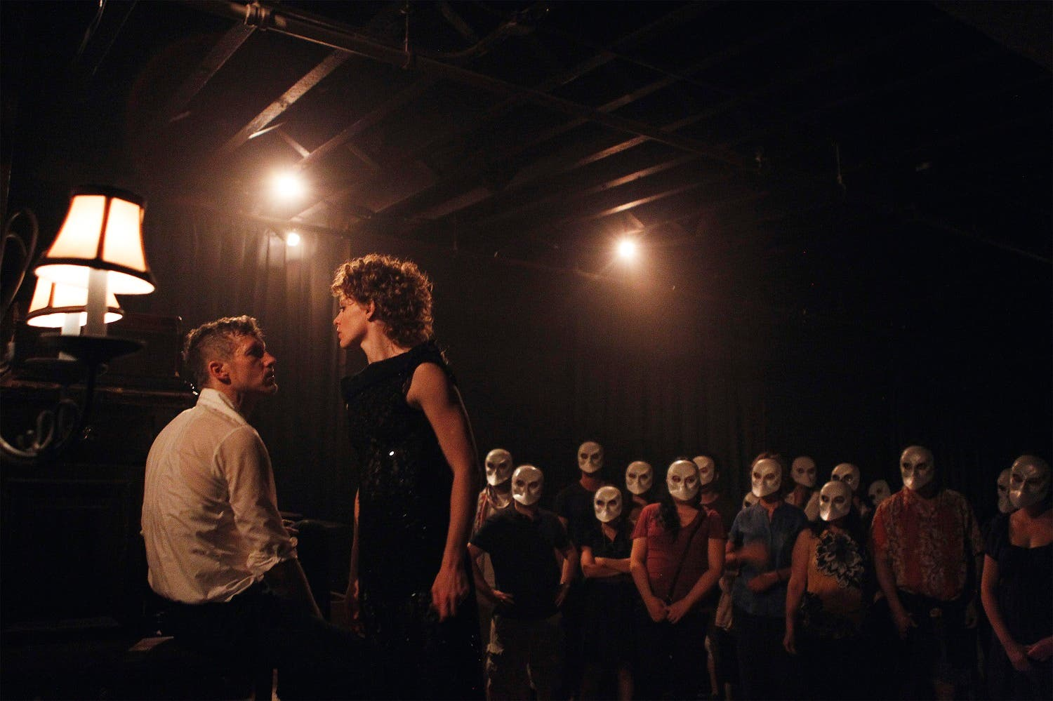 """Actors Eric Jackson Bradley and Tori Sparks perform the parts of Macbeth and Lady Macbeth in a production of """"Sleep No More"""" in New York July 25, 2011. (File Photo: Reuters)"""