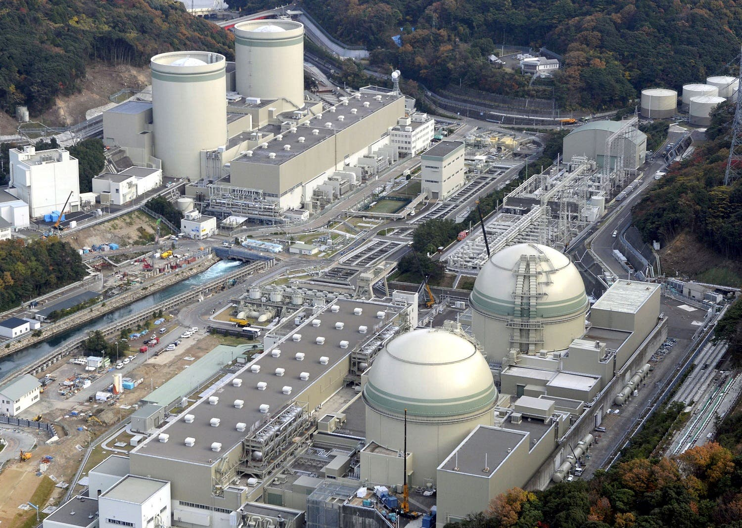 An aerial view shows No. 4 (front L), No. 3 (front R), No. 2 (rear L) and No. 1 reactor buildings at Kansai Electric Power Co.'s Takahama nuclear power plant in Takahama town, Fukui prefecture. (Reuters)
