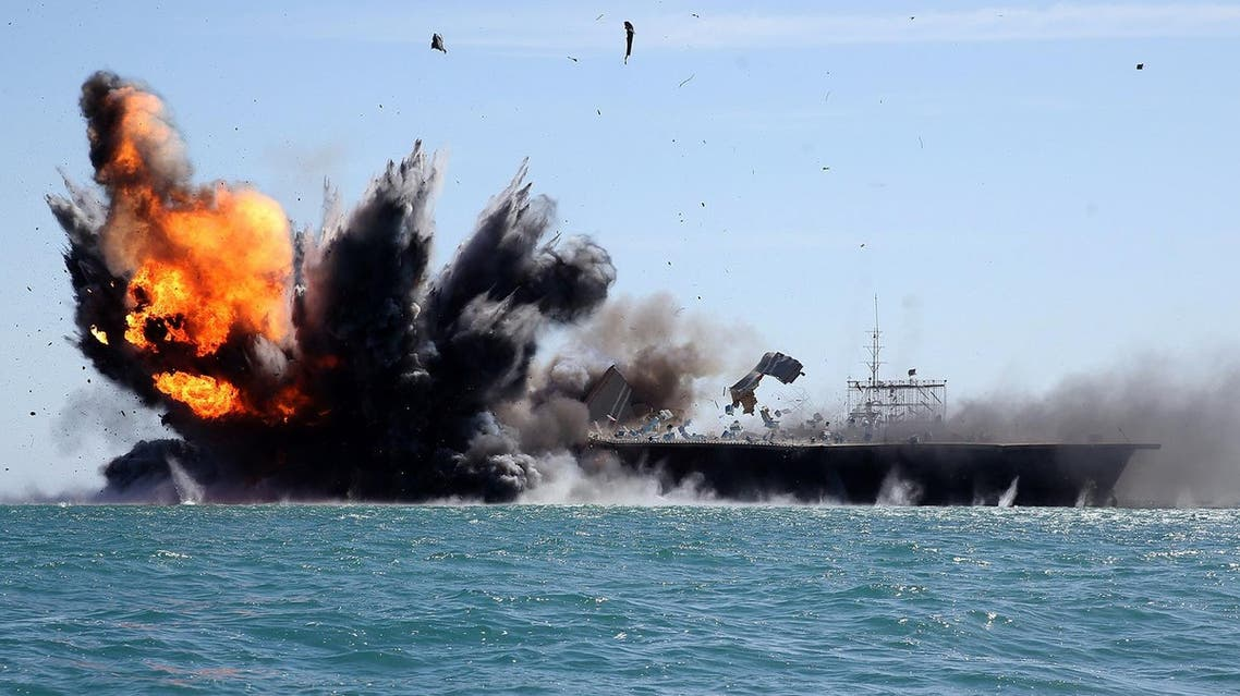 Iran's elite Revolutionary Guard troops attacks a naval vessel during a military drill in the Strait of Hormuz in southern Iran on February 25, 2015. (AP)