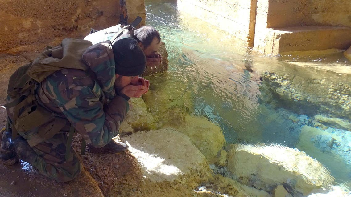 Syrian government soldiers drink from a water pumping station in the village of Ain al-Fija in the Wadi Barada valley near Damascus, Syria in this handout picture provided by SANA on January 29, 2016. SANA/Handout via REUTERS ATTENTION EDITORS - THIS IMAGE WAS PROVIDED BY A THIRD PARTY. EDITORIAL USE ONLY. REUTERS IS UNABLE TO INDEPENDENTLY VERIFY THIS IMAGE. TPX IMAGES OF THE DAY