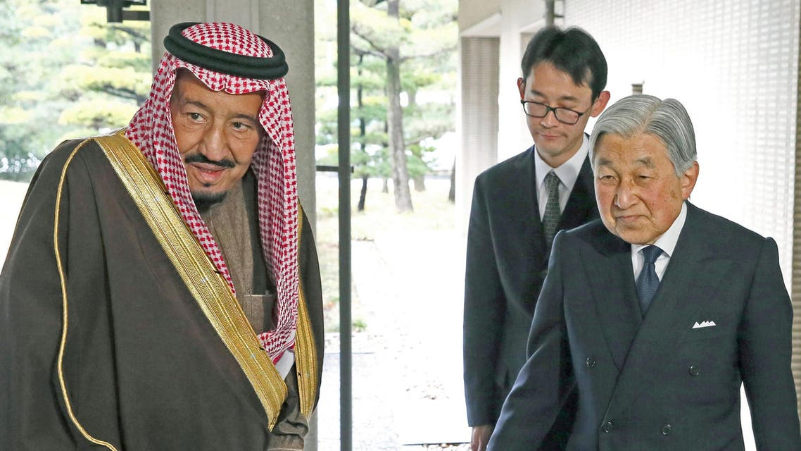 Saudi King Salman bin Abdulaziz Al-Saud (L) is welcomed by Japan's Emperor Akihito (R) upon his arrival for a luncheon at the Imperial Palace in Tokyo, Japan, in this photo released by Kyodo March 14, 2017. Mandatory credit Kyodo/via REUTERS ATTENTION EDITORS - THIS IMAGE WAS PROVIDED BY A THIRD PARTY. EDITORIAL USE ONLY. MANDATORY CREDIT. JAPAN OUT. NO COMMERCIAL OR EDITORIAL SALES IN JAPAN.