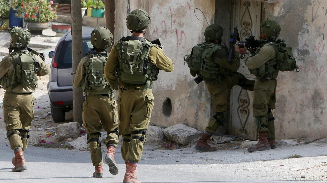Israeli soldiers conduct searches in the northern West Bank village of Madama on August 24, 2016 after a Palestinian reportedly exited a car and stabbed an Israeli soldier on a road close to the village and to the Israeli settlement of Ariel. (AFP)