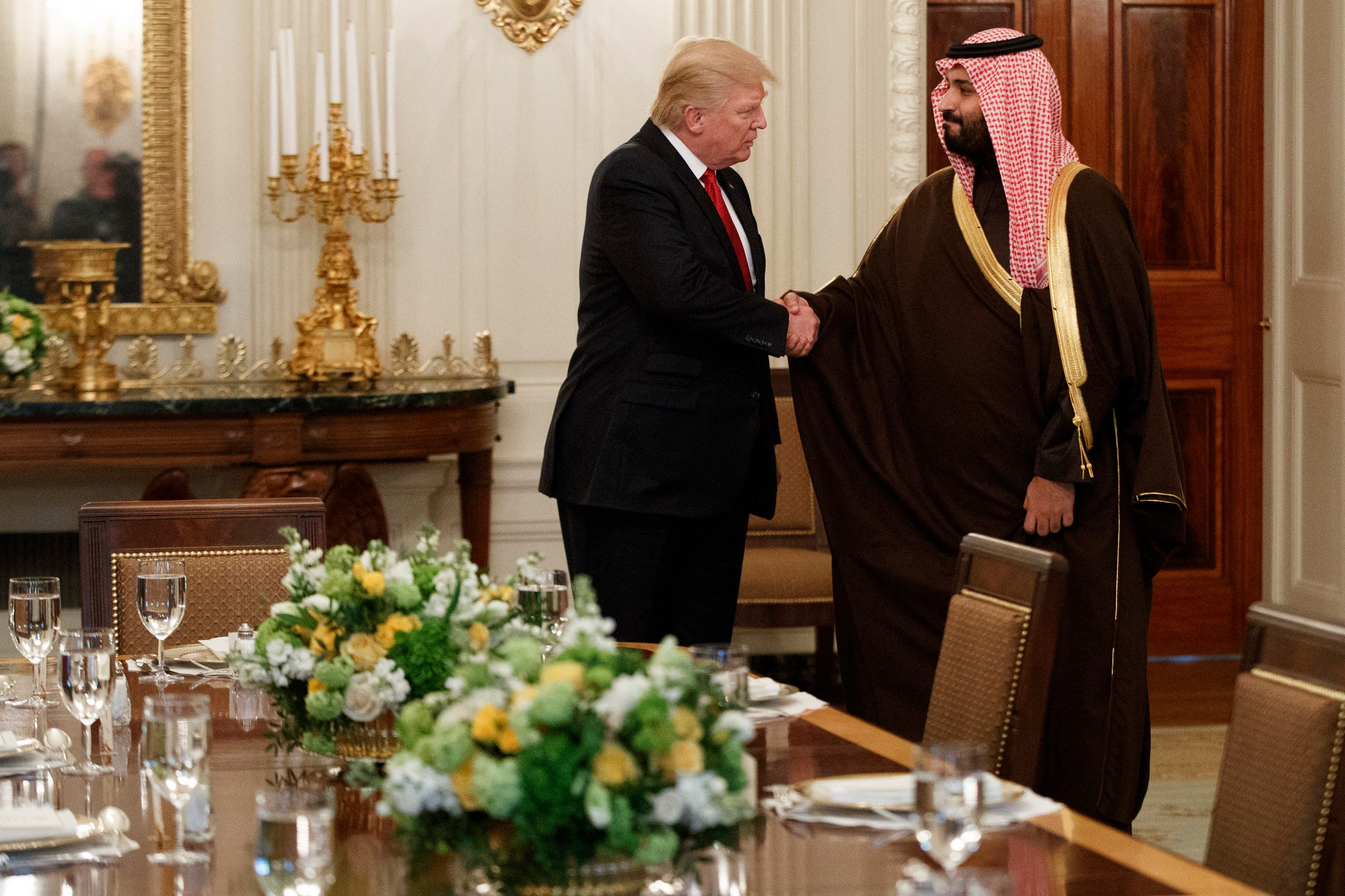 President Donald Trump shakes hands with Saudi Defense Minister and Deputy Crown Prince Mohammed bin Salman, Tuesday, March 14, 2017, in the State Dining Room of the White House in Washington. (AP Photo/Evan Vucci)