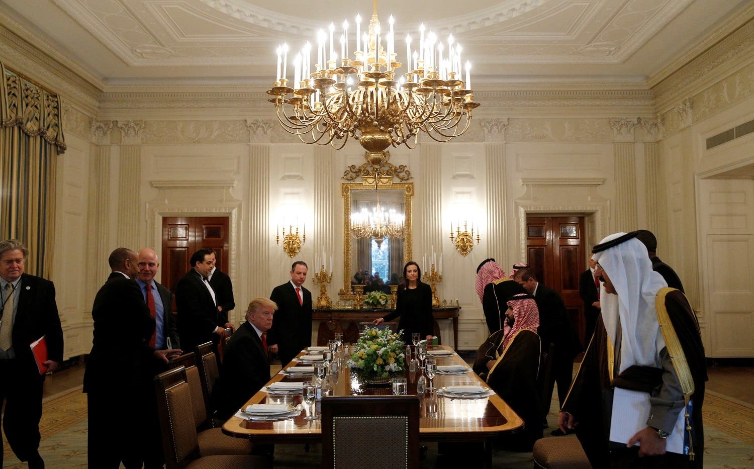 Donald Trump and Saudi Deputy Crown Prince Mohammed bin Salman take their seats for lunch in the State Dining Room of the White House in Washington, US, March 14, 2017. (Reuters)