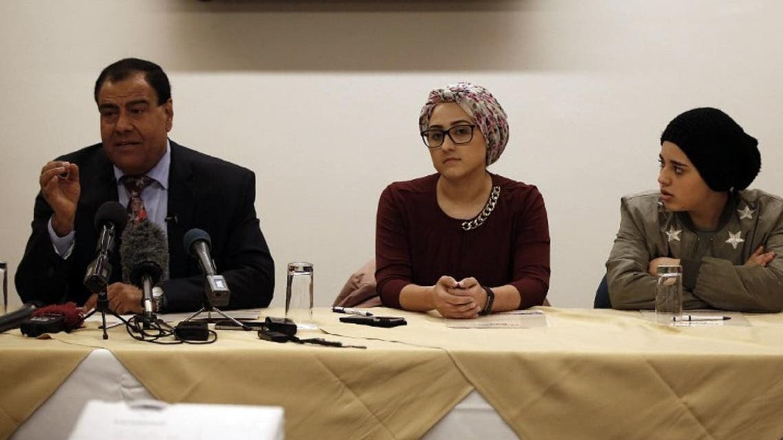 Palestinian doctor Izzeldin Abuelaish (L) and two of his daughters Shada (R) and Rafa give a press conference on March 14, 2017 in East Jerusalem on the eve of a civil trial in Israel that could award compensation for the death of his three daughters and niece killed in the 2008-9 Gaza war. (AFP)
