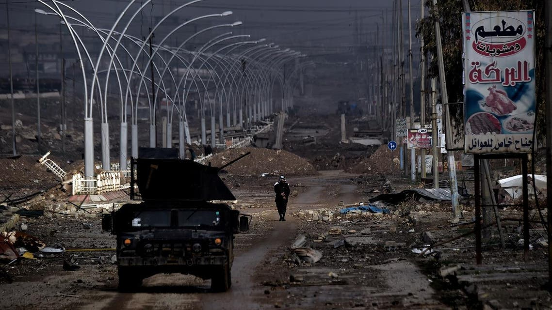 A man walks along a damaged avenue in west Mosul on March 14, 2017, as the Iraqi forces continue to advance in the embattled city combatting Islamic State (IS) group fighters. (AFP)