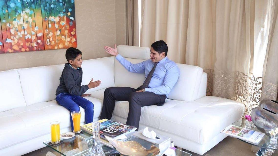 Egyptian tycoon Ahmed abu-Hishaimah with Cairo's street child 11-year-old Abdulrahman.