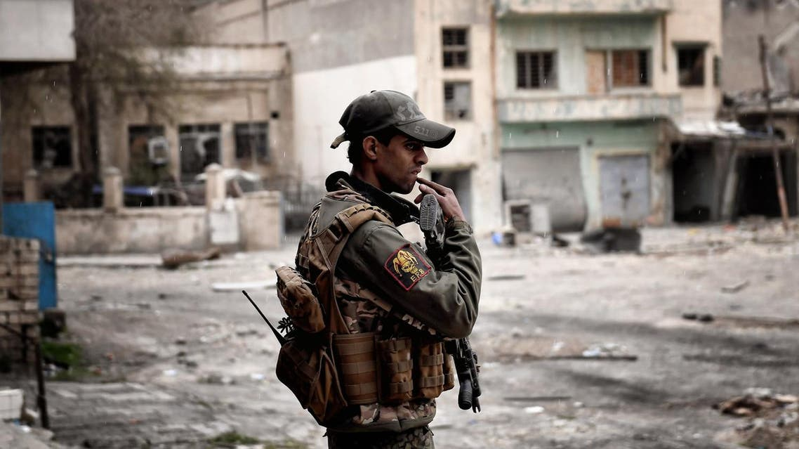 A member of the Iraqi forces holds a position in a western neighbourhood of Mosul on March 13, 2017, during an offensive to retake the city from Islamic State (IS) group fighters.  ARIS MESSINIS / AFP