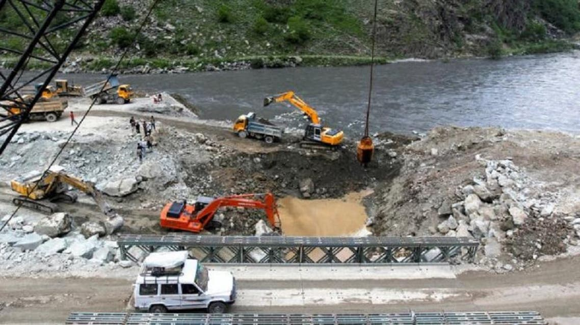 A private vehicle crosses a bridge as excavators are used at the dam site of Kishanganga power project in Gurez, 160 km north of Srinagar June 21, 2012. (File photo/Reuters)
