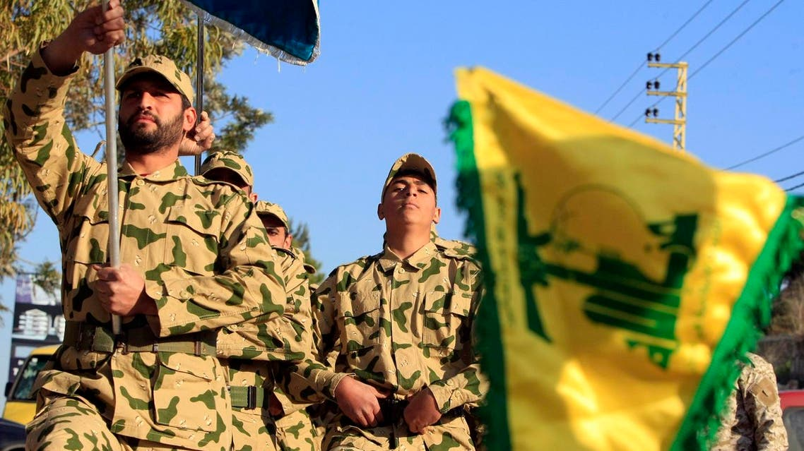 Hezbollah fighters parade during a ceremony to honor fallen comrades, in Tefahta village, south Lebanon, Saturday, Feb. 18, 2017. (AP)