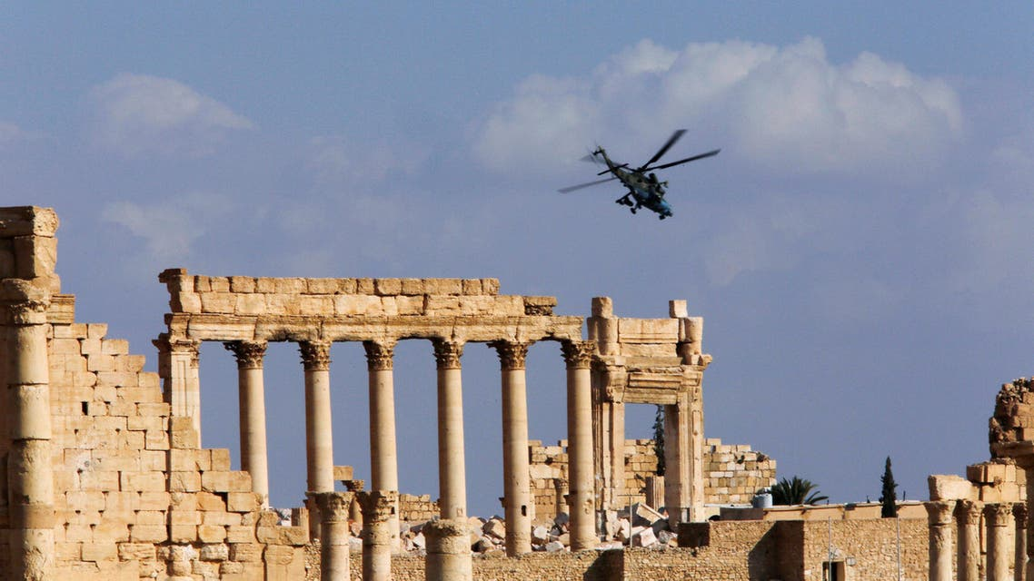 A Russian helicopter flies over the Temple of Bel in the historic city of Palmyra, Syria March 4, 2017.