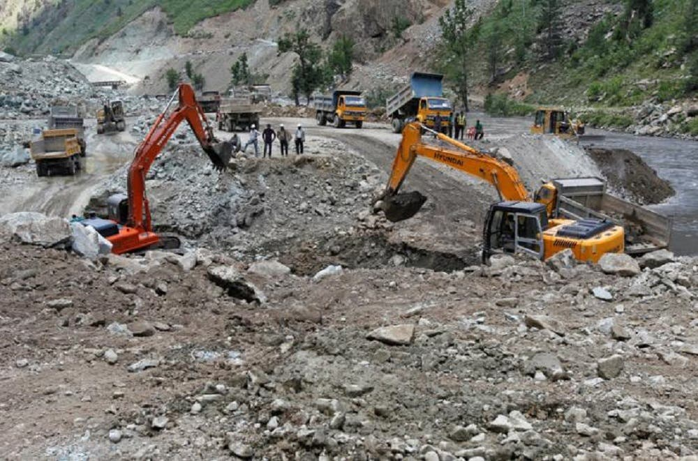 Excavators are used to dig earth at the dam site of Kishanganga power project in Gurez, 160 km north of Srinagar. (File photo/Reuters)