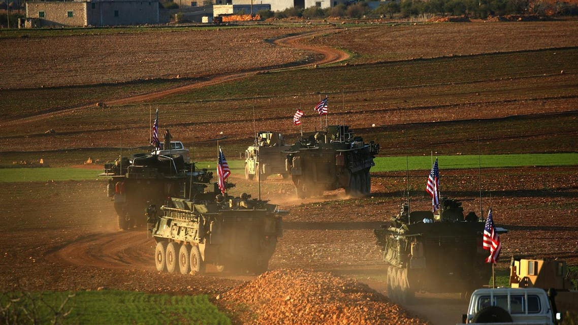 A convoy of US forces armored vehicles drives near the village of Yalanli, on the western outskirts of the Syrian city of Manbij, on March 5, 2017. (AFP)
