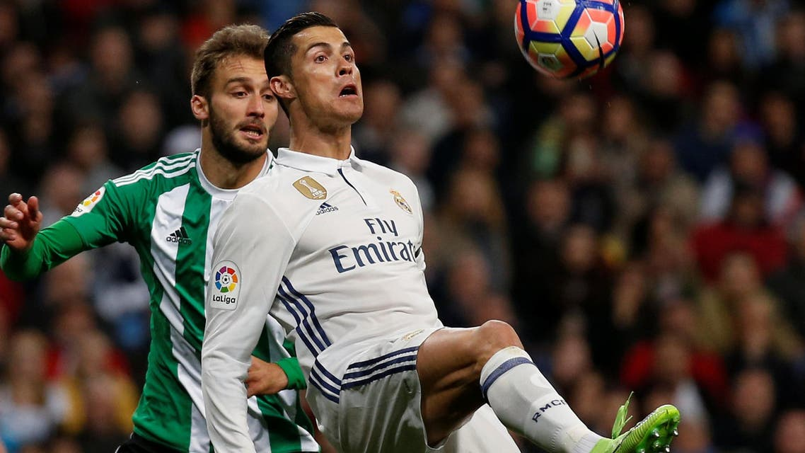 Real Madrid's Cristiano Ronaldo (R) and Real Betis' German Pezzella in action. reuters