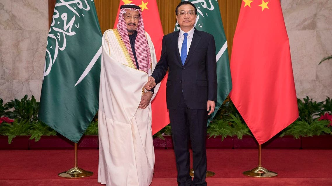 Chinese Premier Li Keqiang (R) shakes hands with Saudi King Salman (L) at Great Hall of the People in Beijing on March 17, 2017. (AFP)