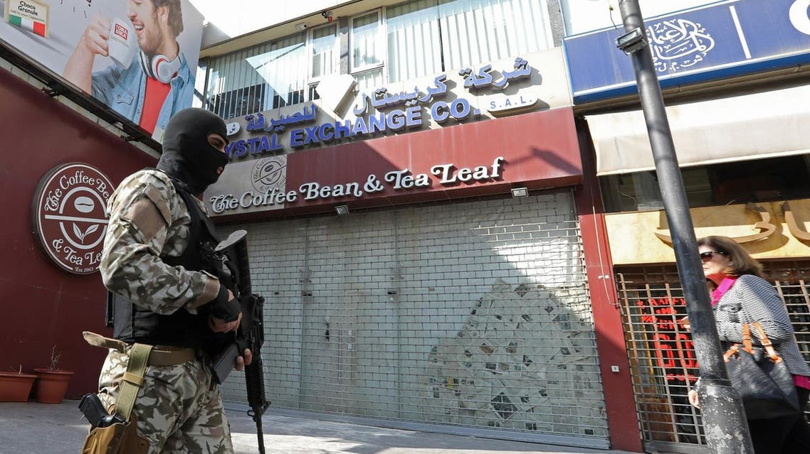A unit from Lebanon's Security Forces carry out raids at banking institutions and financial companies in the commercial Hamra district of Beirut as part of an investigation into cash transfers to the Islamic State (IS) group on March 8, 2017. afp