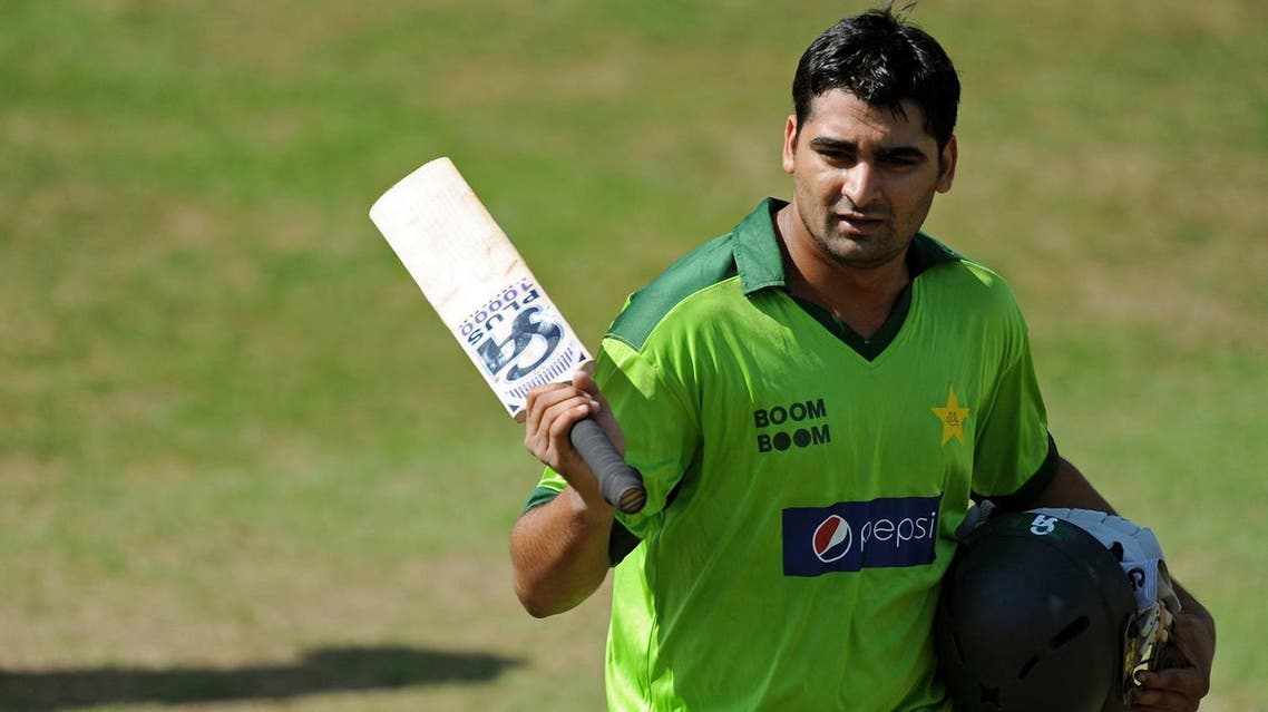 Pakistan's Shahzaib Hasan leaves the field after being dismissed for 105 runs during their match against English county side Somerset, at the County Ground in Taunton, south-west England, on September 2, 2010. (AFP)