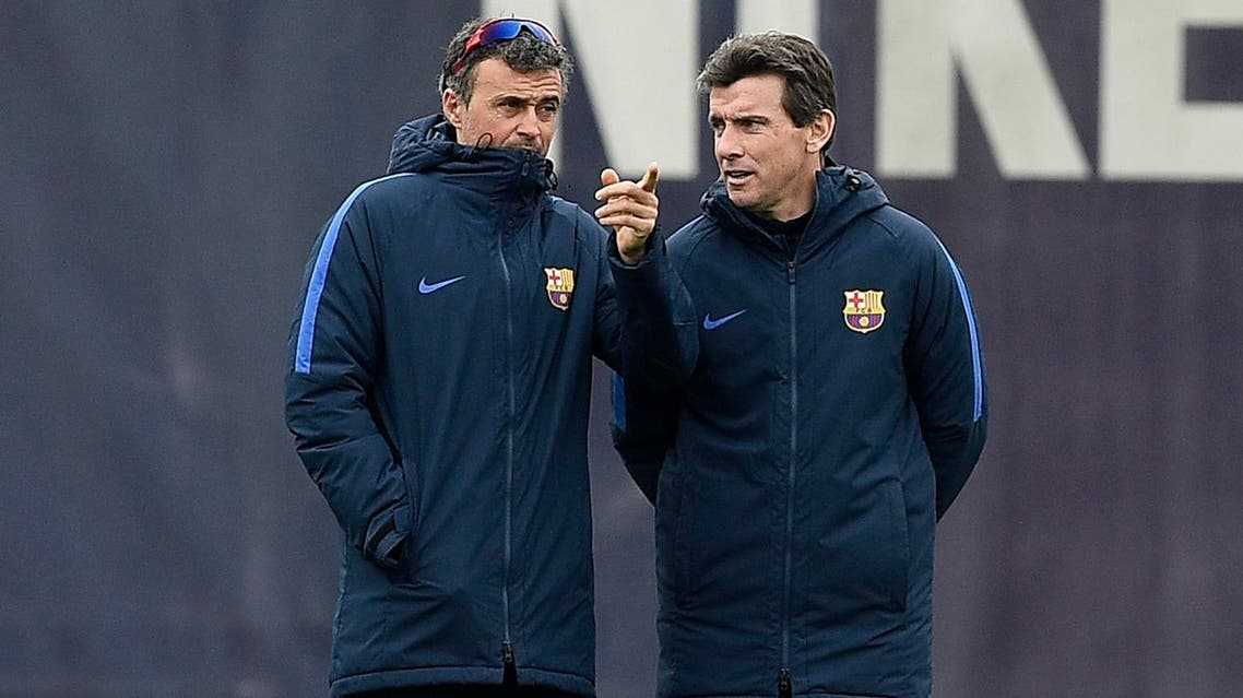 Barcelona's coach Luis Enrique (L) chats with Barcelona's second coach Juan Carlos Unzue during a training session at the Sports Center FC Barcelona Joan Gamper in Sant Joan Despi, near Barcelona on March 3, 2017. (AFP)