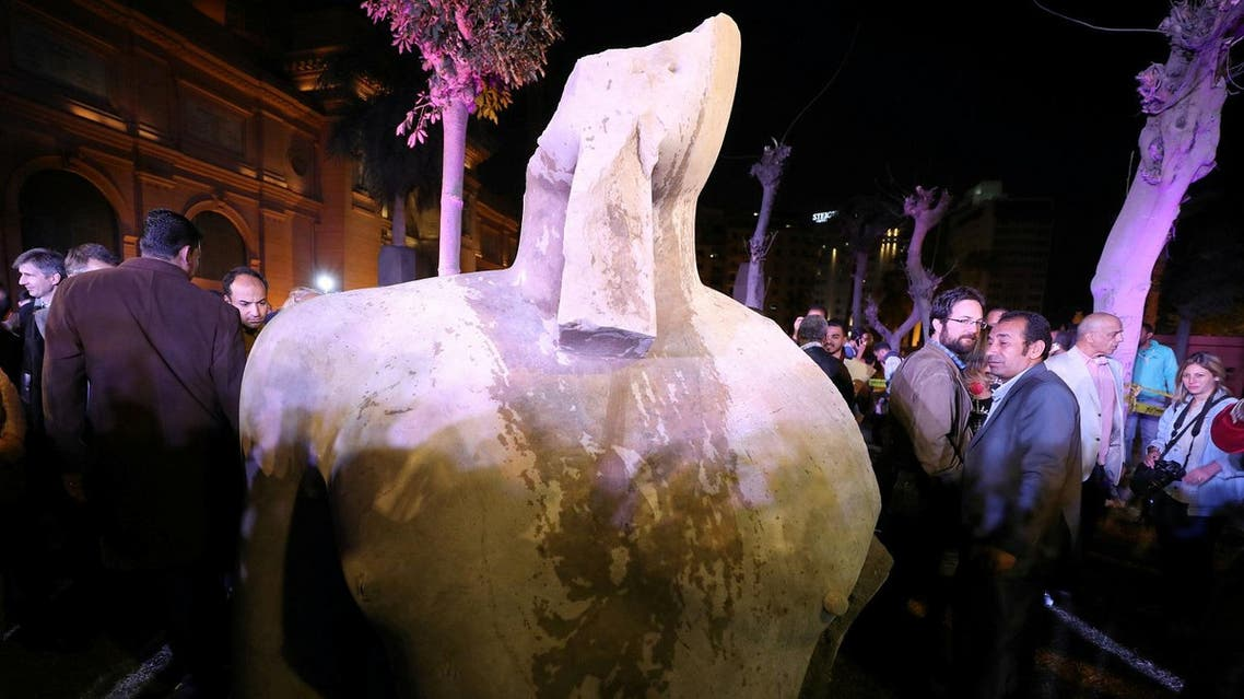 Crowd of onlookers observes a recently discovered colossus now believed to depict Psammetich I in Cairo on March 16, 2017. (Reuters)