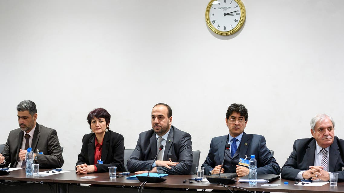 Syria's main opposition delegation with High Negotiations Committee leader Nasr al-Hariri, center, attend a meeting with United Nations special envoy for Syria Staffan de Mistura during Syria peace talks in Geneva. (AP)