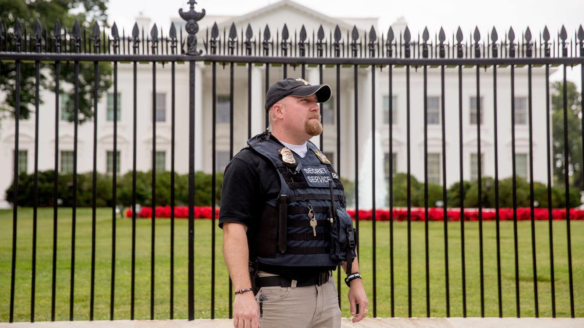 A Secret Service agent stands in front of the fence to the North Lawn at the White House in Washington, Thursday, June 16, 2016