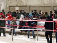 أول دفعة من المقاتلين وعائلاتهم تغادر حي الوعر بحمص