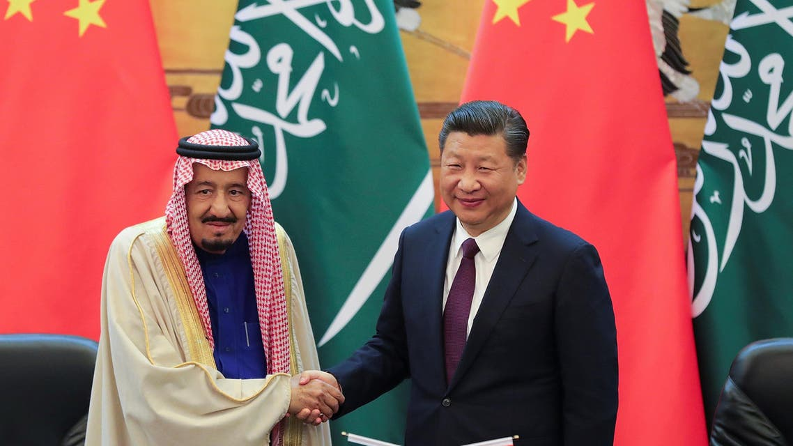 China's President Xi Jinping (R) and Saudi Arabia's King Salman bin Abdulaziz Al-Saud shake hands during a signing ceremony at the Great Hall of the People in Beijing, China March 16, 2017. REUTERS/Lintao Zhang/POOL