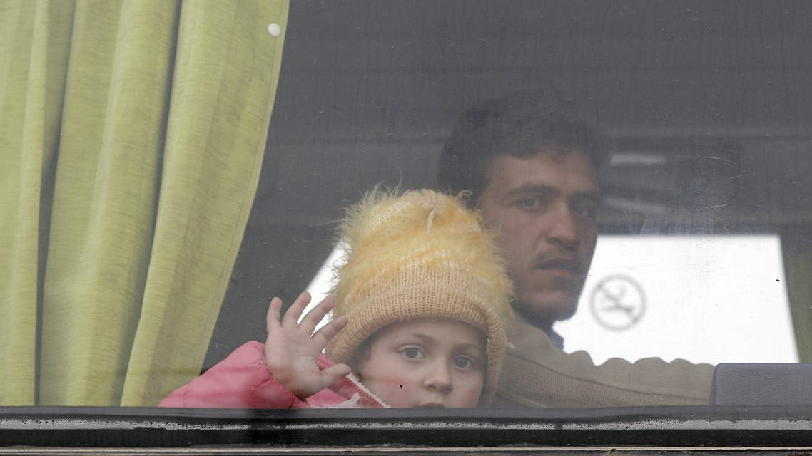 """Families of opposition fighters sits in a bus, following their evacuation from the rebel-held Waer neighbourhood in the central city of Homs on March 18, 2017, during the first phase of the Russian-supervised deal to complete the evacuation of fighters and civilians. The new agreement aims to finalise implementation of a """"reconciliation deal"""" that has already seen several phases of rebel evacuation from Waer district, but which had stalled in recent months."""